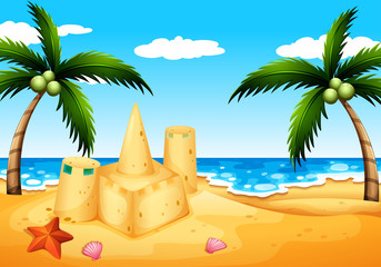 A beach with coconut trees and a sand castle