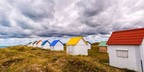 Multicolour huts over the ocean. Beautiful countryside landscape