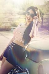 oman wearing stylish elegant designer clothing and sunglasses