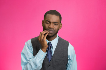 Man with tooth ache, pain isolated on pink background