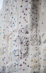 Foor and Hand Holds on Rock Climbing Wall