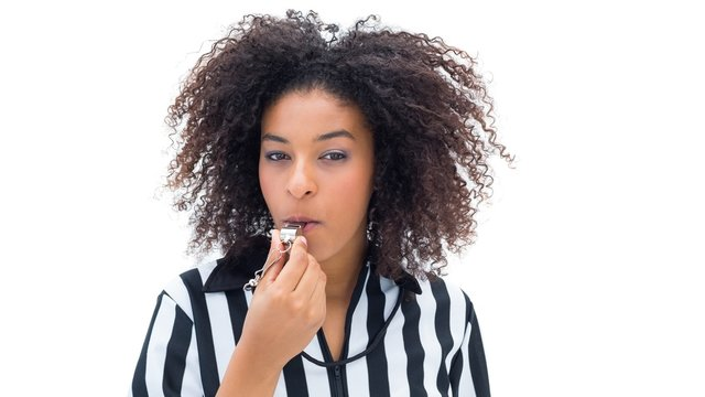 Pretty referee blowing her whistle