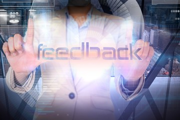 Businesswoman presenting the word feedback