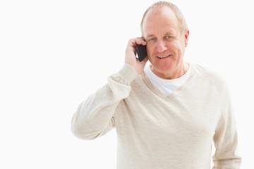 Happy mature man on the phone