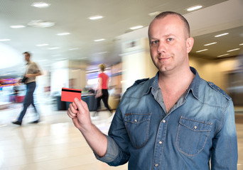 Man holding a credit card in his hand