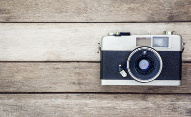 vintage camera in wood background