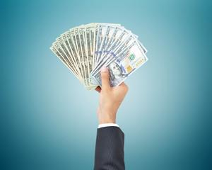 Hand holding money - United states dollar (USD) banknotes