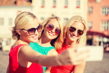 girls taking picture with smartphone camera