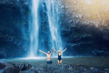 Couple under waterfall