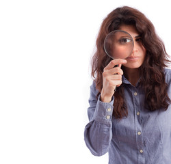 Girl observing with a magnifying glass