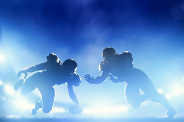 American football players in game, touchdown. Stadium lights Wall mural