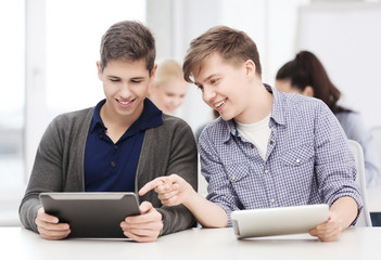 students looking at tablet pc in lecture at school