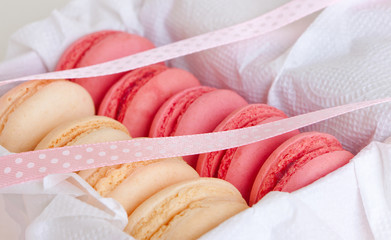 vanilla and strawberry macaroon in a box