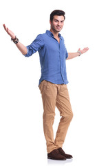 full body picture of a young casual man welcoming