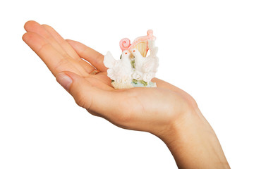Figurine doves on a female hand