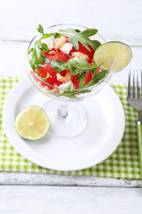 Salad with watermelon, feta, arugula shrimps, balsamic sauce in