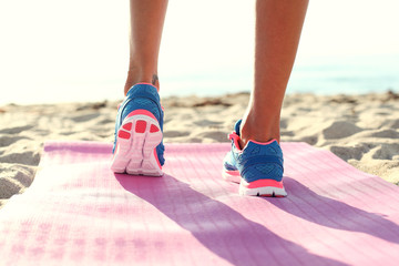 woman running on  the beach. closeup on shoe.