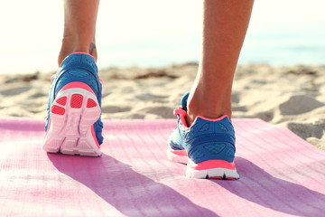 woman running on  the beach. closeup on shoe.