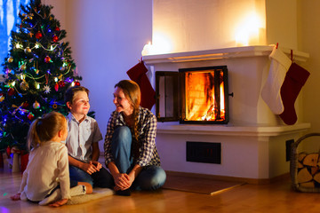 Family at home on Christmas eve