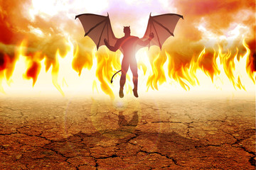 Silhouette illustration of the Devil against fire background