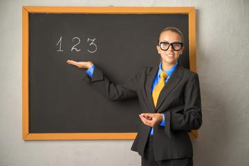 student near the blackboard