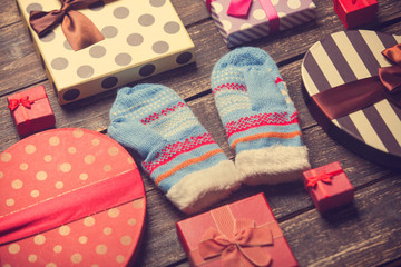 Mittens and christmas gifts around.
