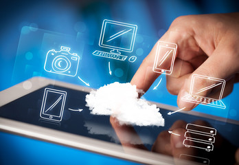 Finger pointing on tablet pc, mobile cloud concept