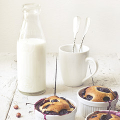 vintage polaroid of clafoutis with blueberries and bottled milk