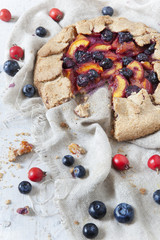 french galette with apricots peaches blueberries and rose hip
