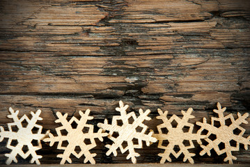 Golden Snowflakes on Wood