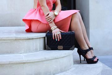 Wall Mural - fashionable woman legs in shoes high heels and handbag outdoor