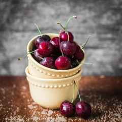 Cherries on rustic wooden background