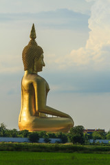 Ancient Big Buddha Image in the Field at Muang Temple ,Thailand
