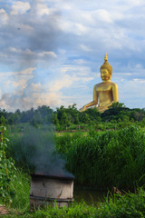 Ancient Big Buddha Image in the Field at Muang Temple , Thailand