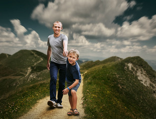 Son with father running on the footpath