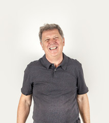 Handsome middle age man studio portrait on a white background