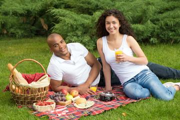 Happy international couple having a picnic