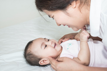Picture of happy asian mother with adorable baby