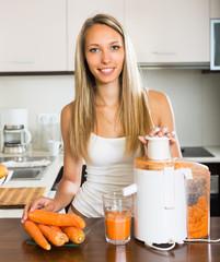 Girl making carrot juice