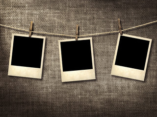 Polaroid style photographs hanging on a clothesline