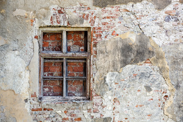 Closed blocked window and old stone wall background