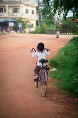 Little girl on the bike in Asia