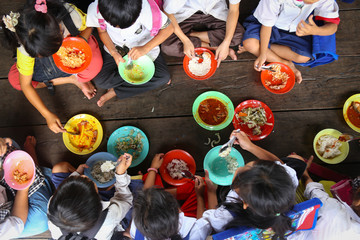 Children having lunch in asian school