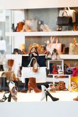 shoes on shelves of shop