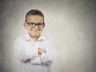 Happy confident little boy, little man isolated grey background