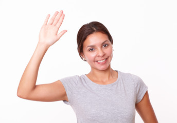Pretty young woman with greeting hand