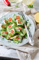 Salad with cucumber, pepper and poppy seeds