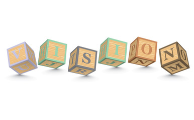 Word VISION written with alphabet blocks