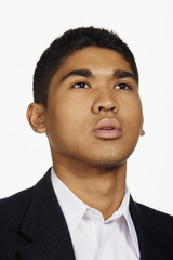 Close up studio shot of Asian man looking up