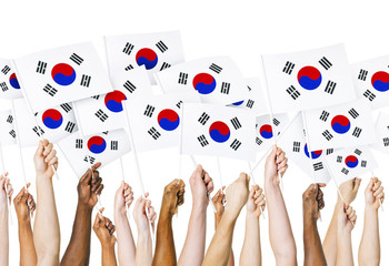 Human Hands Holding South Korean Flag